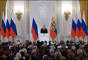 Russian President Vladimir Putin addresses the Federal Assembly in the Kremlin in Moscow, today.