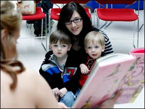 Erin Hensel, and her sons Paxton Hensel, left, 3 and Finnian Hensel, right, 23 months, from Maumee.