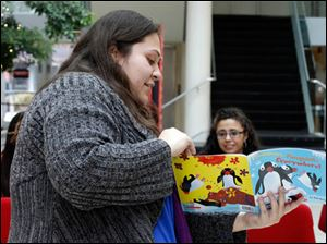 Natalie Guzman, from Adalant, reads Penguins, Penguins, Everywhere! by Bob Barner.