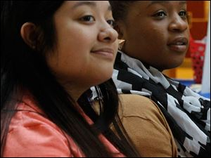 Yajaira Parga, left, and Jamie Winn, right, listen to readers.