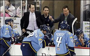 John Vigilante, left, and Derek Booth filled in for Walleye interim head coach Dan Watson, who missed the game because of the birth of his daughter.
