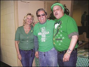 Maureen Gale, Serge Dery, and Tony Gale celebrate St. Patrick's Day at the Ancient Order of Hibernians' party.