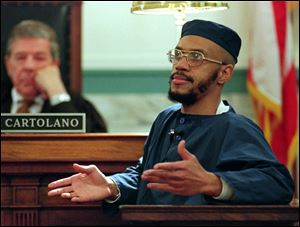 "Siddique Abdullah Hasan, formerly known as Carlos Sanders, testifies before Judge Fred J. Cartolano in Cincinnati, during his trial on aggravated murder, kidnapping, and assault charges. Allowing prison inmates convicted for their role in Ohio's deadly 1993 prison riot to conduct face-to-face media interviews could give them too much ""notoriety and influence"" among fellow prisoners and cause problems throughout the prison system, the state argues in a court filing."