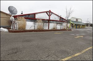 Arnie's Again Bar and Grill, left, and El Nuevo Vallarta restaurants on West Central are slated for demolition as part of a Westgate development plan that drew mixed reviews Wednesday night.