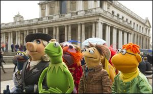 Muppet characters, from left, Gonzo, Miss Piggy, Kermit, Floyd, Walter, and Scooter in a scene from 'Muppets Most Wanted.'