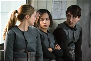 From left, Shailene Woodley as Beatrice 'Tris' Prior, Zoe Kravitz as Christina, and Ben Lloyd- Hughes as Will in the film, 'Divergent.'