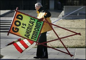 The Rev. Fred Phelps Sr. prepares to protest outside the Kansas Statehouse in Topeka, Kan., in July, 2007.