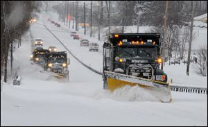 A line of trucks with plows head south on Route 202 between Dilworthtown Road and Route 1 in Birmingham Township, Pa. in February.