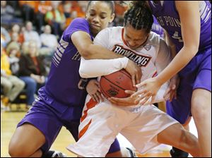 Bowling Green State University player Erica Donovan (21) fights for a rebound with High Point University players Lexi Patterson (2) and Stacia Robertson (4) during the first half.