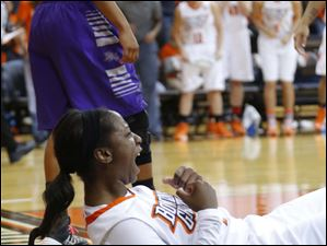 Bowling Green State University player Jasmine Matthews (1) reacts after making the basket and drawing a foul.