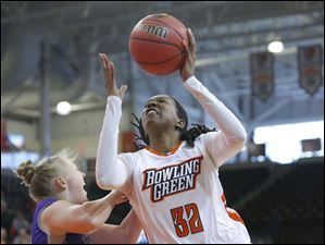 Bowling Green State University player Alexis Rogers (32) puts up a shot against High Point University player Teddy Vincent (23) during the first half.