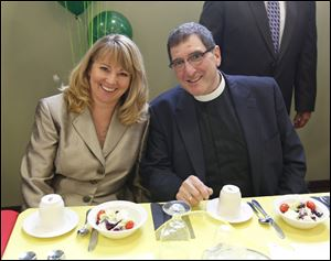 Presbytera Debbie Damaskos, left, the Rev. Aristotle W. Damaskos at the luncheon in his honor.