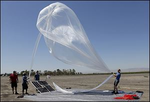 A Google team launches a high-altitude balloon carrying electronic testing equipment into the skies above Dos Palos, Calif.