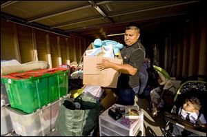Carlos Jijon works to move things out of the garage of his house in Buena Park, Calif. Mr. Jijon and his wife had to navigate a market with tight inventory and investors armed with cash.