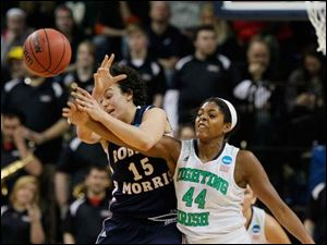 Notre Dame's #44 fouls RMU's Artemis Spanou (15) in the second period.