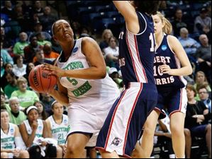 Notre Dame's Kristina Nelson (5), is defended by RMU's Aretmis Spanou (15). At right is RMU's Rebeca Navarro (10).
