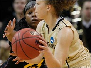 ASU's #23, Elisha Davis reaches for the ball controlled by VU's Jasmine Jenkins (15).