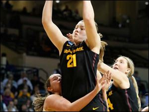 ASU's Sophie Brunner (21) grabs a rebound and VU's Kristen Gaffney (24) gets a mouthful of uniform in the second half.