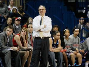 RMU coach Sal Buscaglia in front of his bench.