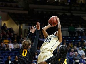 Vanderbilt's Christina Foggie (10) shooting a fall away jumper in front of ASU's Katie Hempen (0) and Elisha Davis (23).