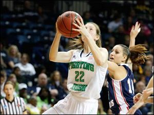 Notre Dame's Madison Cable shooting for two in the second period. RMU's Ashley Ravelli (14) is behind her.