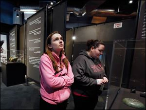 Laura Smith of South Jersey and Kasey Gregg of Tiffin, Ohio, look at artifacts on display.