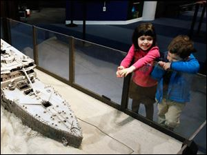 Nina Rubinstein, 5, and her brother Jake Rubinstein, 3, of New York look at a replica of the Titanic on display.