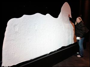 Robin Ziegler of Toledo feels  an iceberg on display.