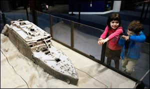 Nina Rubinstein, 5, and her brother Jake Rubinstein, 3, of New York look at a replica of the Titanic on display at the Titanic Artifact Exhibition at Imagination Station.