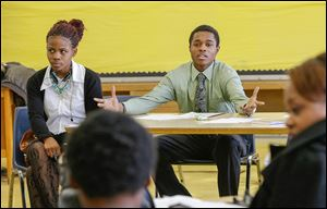 Student Jalen Pickett, center, talks during a class that teaches anger management and conflict resolution skills at Cody High School in Detroit. Jalen, now a diligent student, landed in an intervention program when he began high school.