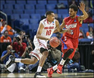 Ohio State's LaQuinton Ross drives past Dayton's Devin Oliver. Ross, a junior, might enter the NBA draft.