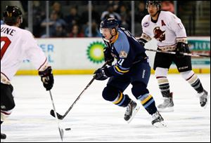 Walleye's Brett Perlini (11) moves the puck against Gwinnett.
