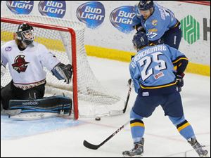The Walleye's Matt Abercrombie front, and Ryley Grantham work together to try and get a goal past Gladiators goalie Mark Guggenberger.