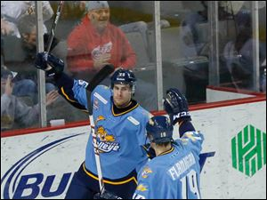 Toledo's Matt Abercrombie, left, celebrates with teammate Ryan Flanigan after scoring a goal.