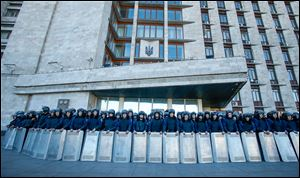 Ukrainian police block a regional administrative building during a pro-Russian rally in Donetsk. About 5,000 demonstrated in favor of holding a referendum on secession and absorption into Russia, similar to Crimea's. (AP Photo/Sergei Grits)