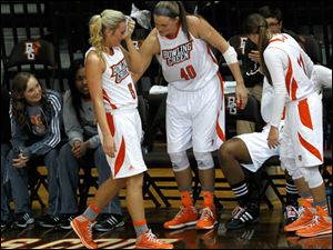 BGSU's Deborah Hoekstra, 3,  returns to the bench after being checked out for an eye injury.
