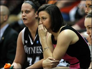 St. Bonaventure associate head coach Kate Achter, center, watches her former BGSU basketball team build a large lead.
