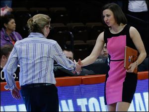 BGSU head coach Jennifer Roos, left, greets former BGSU player and current St. Bonaventure associate head coach Kate Achter.