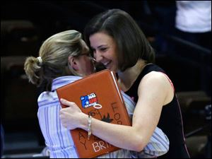 BGSU head coach Jennifer Roos, left, hugs former BGSU player and current St. Bonaventure associate head coach Kate Achter.