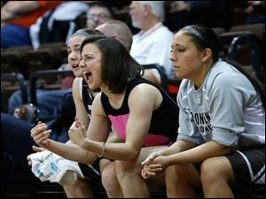 Former Clay High School and BGSU basketball standout Kate Achter yells from the St. Bonaventure bench.