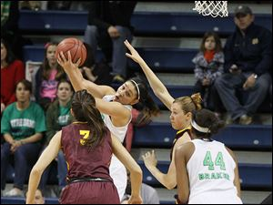 Notre Dame's Natalie Achonwa pulls down an offensive rebound in front of Arizona State's Joy Burke, left, teammate Ariel Braker, and ASU's Eliza Norman, in the first half. Achomwa had 25 points.