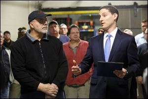 Ohio Treasurer Josh Mandel, right, presents John Incorvaia, an employee of Toledo Metal Spinning, with the first 'Ohio Strong' award. The new award will recognize local workers in manufacturing and the skilled trades, and encourage more people to pursue careers in these fields.