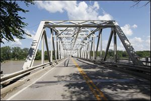 A new bridge immediately next to the existing structure or one angling across the Maumee River toward Farnsworth Road are two of three options the Ohio Department of Transportation is considering for replacing the Waterville Bridge.