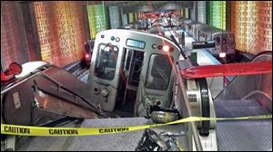 A Chicago Transit Authority train car rests on an escalator at the O'Hare Airport station after it derailed early today in Chicago. More than 30 people were injured.