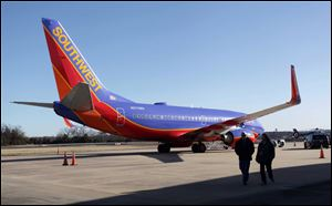 Southwest Airlines Flight 4013 sits at the M. Graham Clark Downtown Airport in Hollister, Mo., on Jan. 13.