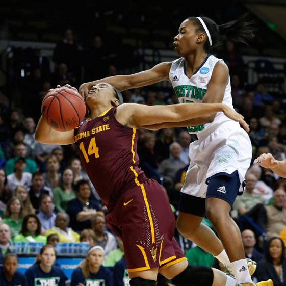 ASU-14-Adrianne-Thomas-is-fouled-in-the-first-half-by-UND-s-15-Lindsay-Allen