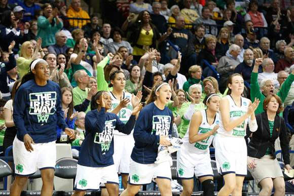 UND-players-and-fans-applaud-after-a-Jewel-Loyd-score