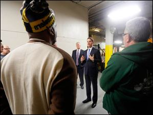 Ohio Treasurer Josh Mandel, center, speaks with employees of Toledo Metal Spinning after handing out the first