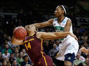 ASU #14, Adrianne Thomas, is fouled in the first half by UND's #15, Lindsay Allen.
