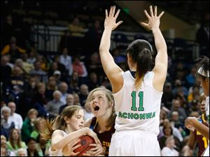 ASU's #21, Sophie Brunner, is blocked by UND's #11, Natalie Achonwa, and the ball is tied up by UND's #22, Madison Cable, for a jump ball in the first half.